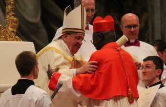 Pope Francis embraces a new cardinal at the Feb. 22 consistory, February 22, 2014.
