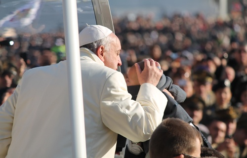 Pope Francis greets pilgrims in St. Peter's Square before the Wednesday general audience Dec. 11, 2013.